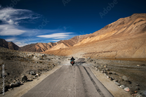 Motorcycle Road trip to the mountain in rural landscape