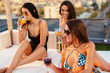 Group of young women have a party in a penthouse - 212884184