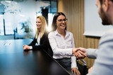 Portrait of business couple in conference room - 212884927