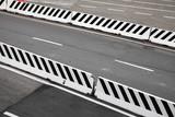 Road with striped concrete border blocks - 212887354