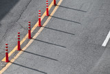 Dividing line and red plastic warning poles - 212887361