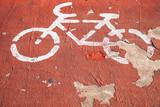 Bicycle lane. Grungy white road marking - 212887363