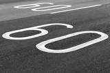 60 km per hour. Speed limit road marking - 212887369