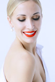 model with professional make-up and bright red lips / beautiful make-up on the face of the model, saturated with bright red lipstick on the lips - 212888984