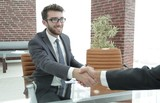 closeup. handshake between the financial Manager and the client - 212896746
