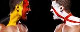 Soccer or football fan athlete with bodyart on face - flag of Belgium vs England. - 212898393