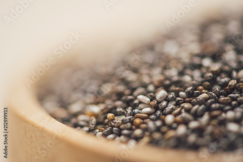 Close-up of raw, unprocessed, dried black chia seeds - 212899933