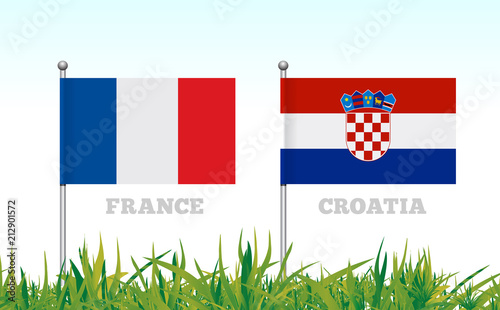 Flags of France and Croatia against the backdrop of grass football stadium.