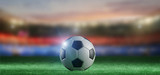 Football ball on the field of a world cup stadium - 3d rendering - 212901939