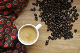 Cup of espresso in white cup with coffee beans on wooden background - 212908799