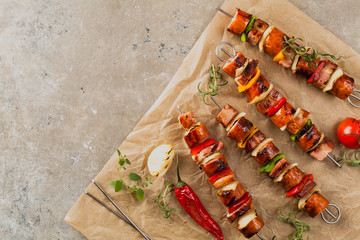 Grilled skewers with sausage, bacon and vegetables. © gkrphoto
