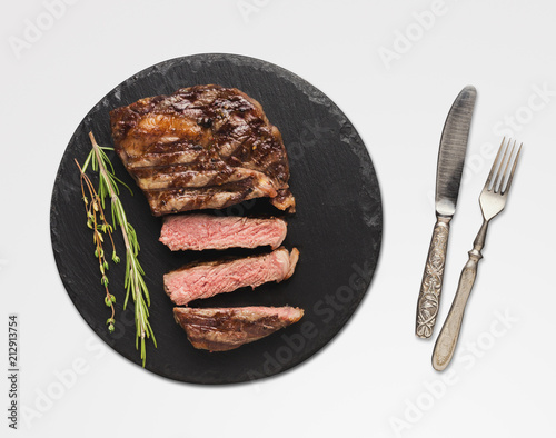 Rib eye steak and spices on white isolated background - 212913754