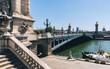 Pont Alexandre III bridge over river Seine. Bridge decorated with ornate Art Nouveau lamps and sculptures. Paris, France