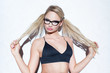 Sexy bonde woman in glasses pulling pigtails