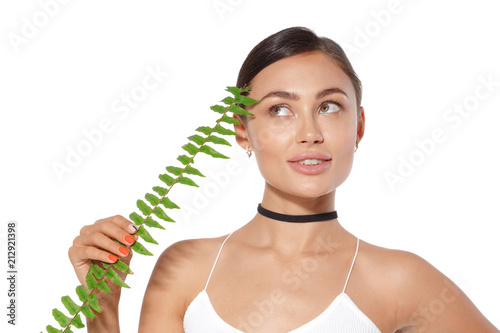 Leinwanddruck Bild model with natural make up and green leaf isolated on white. Spa and wellness.