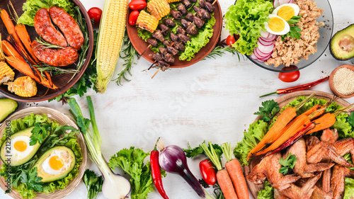 Wall mural Food. Avocado dishes, chicken wings, omelet and barbecue. On a wooden background. Top view. Copy space.