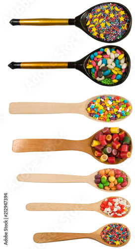 isolated caramel candy on a wooden spoon