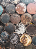 Closeup of old rusted colorful barrels from fuel or oil products - 212956976