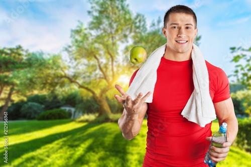 Leinwanddruck Bild Athletic man with towel on neck