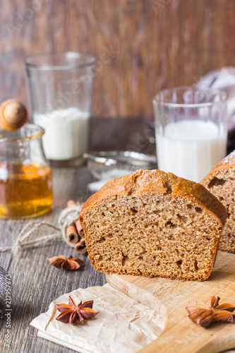Spicy honey cake with sugar powder served on rustic background. Honey cake for Rosh Hashanah. - 212957373