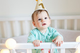 Portrait of cute baby girl wearing birthday hat, one year old birthday celebration . - 212959512