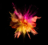 Explosion of coloured powder on black background - 212964529