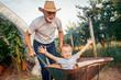 Leinwanddruck Bild - Happy grandfather and his grandson having fun together