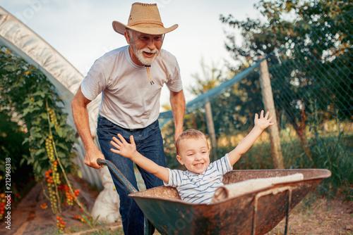 Leinwanddruck Bild Happy grandfather and his grandson having fun together