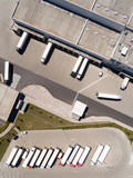 Aerial view of warehouse with trucks. Industrial background. Logistics from above.  - 212968718