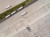 Aerial view of warehouse with trucks. Industrial background. Logistics from above.  - 212968747
