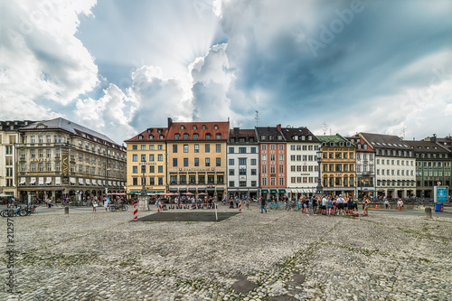 Foto Murales Munich, Germany June 09, 2018: Old houses in the city of Munich at the Residenzstrasse, Germany. People walk through the streets of Munich.