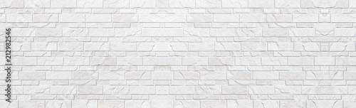 Panorama of white modern stone wall pattern and background