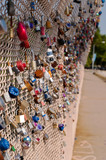 Locks signifying a couples love for one another on a bridge's chain fence in Pittsburgh, Pennsylvania, USA - 212986371