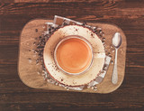 cup of coffee with roasted beans on wooden table - 213015701