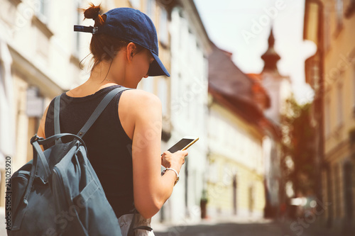Woman tourist with backpack on street of Ljubljana, Slovenia.
