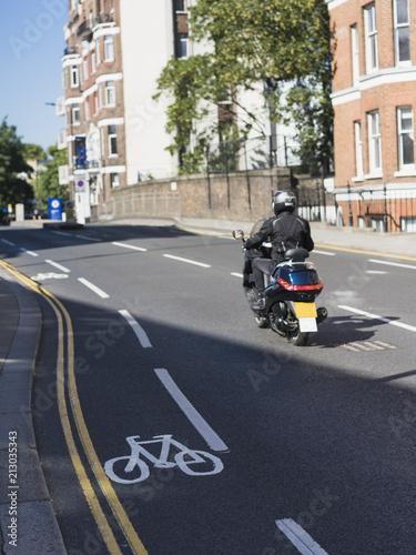 Fotobehang Scooter Man riding moped in helmet