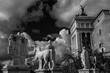Capitoline Hill monumental balustrade with ancient roman statues and clouds in the historic center of Rome (Black and White)
