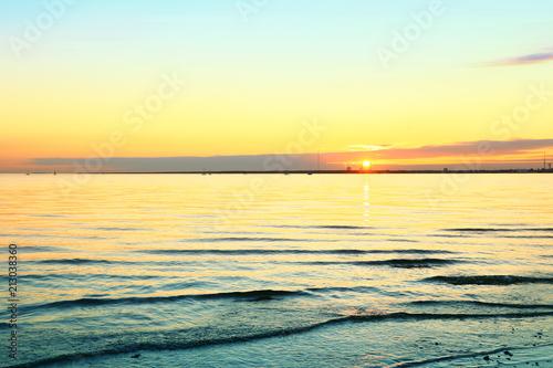 Foto Spatwand Zwavel geel beautiful sunset on the coast sea