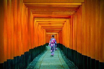 Asian women in traditional japanese kimonos at Fushimi Inari Shrine in Kyoto, Japan. © tawatchai1990
