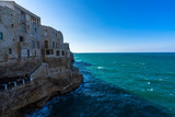 Polignano a Mare is a famous town built on rocky cliffs overlooking the Adriatic Sea, Apulia, Italy - 213049106