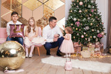Portrait of beautiful happy family, merry father, daughter and son are sin Christmas decorations, - 213052194