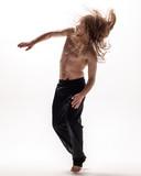 Young beautiful dancer posing in the studio - 213055107