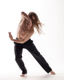 Young beautiful dancer posing in the studio - 213055115