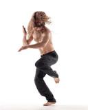 Young beautiful dancer posing in the studio - 213055154