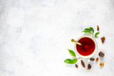 Cup of tea, rock of sugar and fresh green tea leaves, copy space - 213065765