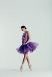 Young beautiful pregnant ballerina is posing in studio - 213071321