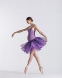 Young beautiful pregnant ballerina is posing in studio - 213071333