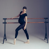 Young beautiful pregnant ballerina is posing in studio - 213071346