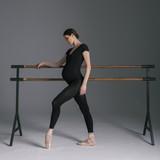 Young beautiful pregnant ballerina is posing in studio - 213071363