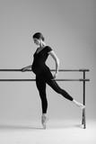 Young beautiful pregnant ballerina is posing in studio - 213071758